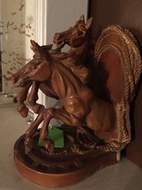 Carved wooden horses bookends