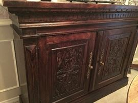 Custom hand carved and stained buffet.