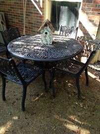 Cast aluminum patio table and 4 chairs