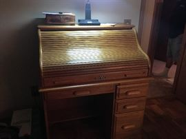 This is a beautiful roll top desk in oak.