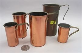 set of nested copper measuring cups
