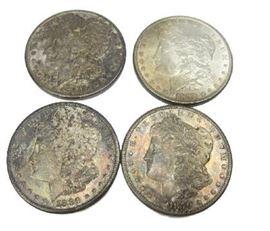 Toned AU and BU Morgan silver dollars