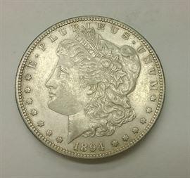 1894 Morgan Silver Dollar. VERY RARE DATE. Rim Flaw. Auction estimate $600-900