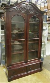 Edwardian display hutch.  Original rolled glass.  Case rests on base with drawers