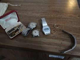 3 watches , pins and clips.