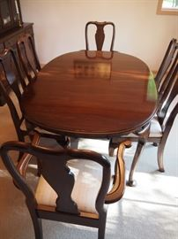 Dining room table, six chairs, leafs and table pads (other matching pieces available)