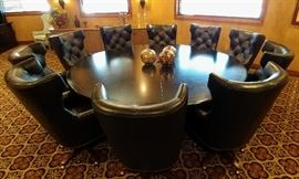 Beautiful large round wood conference table and chairs. Table approximate measurements are 9' L x 3' H. Chairs all leather with pin cushion design.
