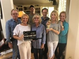 And the winner is... for best Esatate sale co. Griffin &  Team, holding a real clapper & real Golden Globe. Sorry Golden Globe is not for sale!