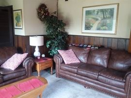 Leather sofa and loveseat with brass studs.  Great condition.