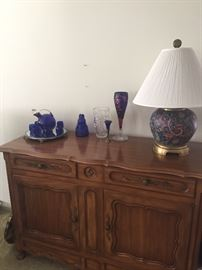 Sideboard - dining table and chairs available that match - also sold separately, blue glassware, crystal and porcelain lamp