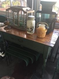 Primitive table with wicker nesting tables, birdcage, decoys, lanterns... just a sampling of the many treasures