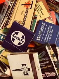 Large collection of matchbooks and ashtrays.