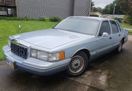Ride in comfort and style with this 1991 Lincoln town car. This vehicle comes in a light blue with grayish blue interior. This item features power locks power doors power seat, am FM radio, tape deck, V8 overhead Cam engine. The miles on his vehicle are 119,655.  Currently this vehicle is in running condition but has not been taken outside of neighborhood roads. It has been sitting for a couple years and will need fresh gas. There are some nicks and dings in the exterior to include  Yellow paint on the passenger side a Dang in the rear passenger side bumper, crack and the we're passenger side Light and the trunk key emblem cover is missing.  For further information on this vehicle the Vin number is ILNCM82WOMY679336. Please see pictures and video for further details.  There will be several opportunities to view this vehicle in person.