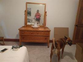 Birdseye maple bedroom set, includes dresser with mirror shown (photo-bombing dog not included!), full-size bed, oval table, rocker, & straight chair. Original finish. See next 4 pictures.
