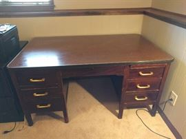 Man-sized desk! 1940's vintage. Huge! One file drawer, 4 box drawers, pull-out work surface on each side. Original finish.