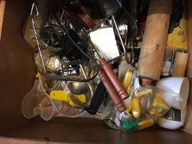 LOTS of kitchen utensils.
