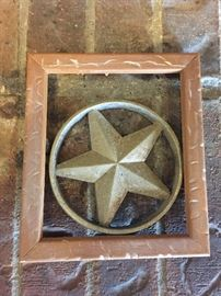 Metal star in wooden frame