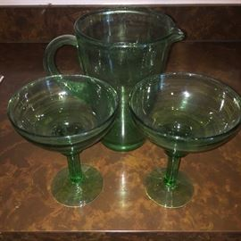 Green glass pitcher and two margarita glass