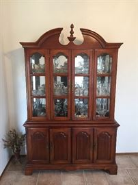 Super nice china hutch loaded with glass shelves and front and mirrored back. Lots of storage underneath