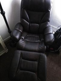 2 leather theater chairs  1 year old   Paid 1400.00 Never been used  500.00 each or best offer