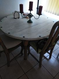 Round table  4 chairs  150.00