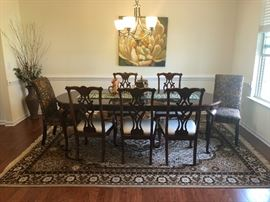 "Thomasville dining room table and 5 matching chairs. Table has 2  16"" leaves.  8' 5"" when fully extended."