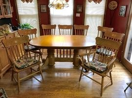 8 Solid Oak chairs go with this beautiful Table-6 side chairs & 2 Capt Chairs