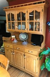 This lovely Oak Cabinet is part of the Dining set hand made by Mennonites Buffalo Furniture Co-Solid-quality-lots of display and storage-sold with Banquet Table as set
