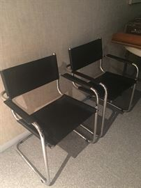 Modern chrome and leather arm chairs - 2 available
