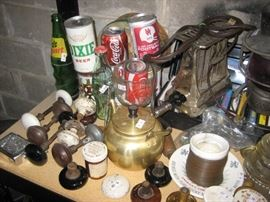 Vintage beer and Coke cans, doorknobs, 1930's toaster, and more.