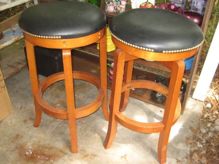 A pair of bar stools in excellent condition.