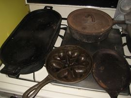 Cast iron pans, dutch oven  and cornbread  molds.