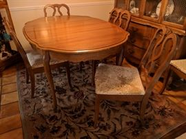 $150  Dining room table with chairs and leaf