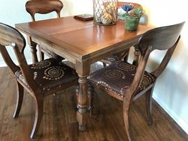 Vintage pub table and chairs. England. Chairs reupholstered with silk material. 4 chairs. Reserved at $1,200.