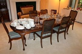 Ethan Allen dining table with 2 leaves, table pads, and 6 chairs