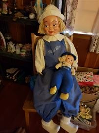 "This was a store display prop from the late 40s to early 50s.  38"" tall to the top of head without hat, and depending how you fluff the hat, this could be up to 44"" tall. He is not made to stand, but does sit nicely in a chair. Rag or cotton batting filled sewn body under the clothes. The shoes are molded plastic in good shape and marked Esther Miller Creations at the heel. The hands are rubber and in great shape. His face is some type of rubber/plastic."
