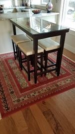 Contemporary Black Lacquer Stools and High Dining Table. One of the wonderful carpets. This one is actually square.
