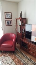 Two very wonderful Rust/Red Leather Barrel Chairs. Two Curio Cabinets. Media Center.