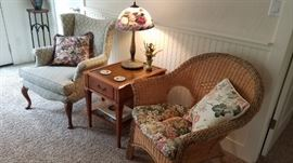 Wingback Chair. Several Side Tables. Wicker Chairs. Decorator Pillows. Glass Shade Lamp.