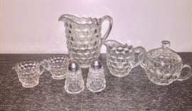Fostoria water pitcher, salt and pepper shakers, small and large cream and sugar sets