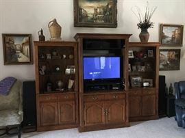 Large wooden entertainment center - rca surround sound - oil paintings