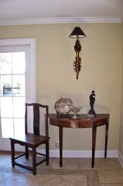 One of a pair of demi-lune tables