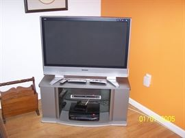 "42"" Panasonic TV , Stand,  wood Magazine rack in Basement"