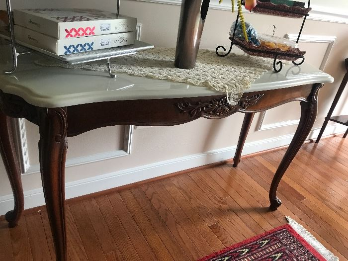 Mohogany tables with marble tops