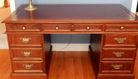 A PERFECT HEKMAN DESK WITH LEATHER TOP