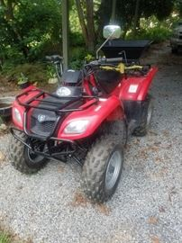 Suzuki Ozark 250. 4 Wheeler. ATV. Great condition! Spreader attached to back for feed or fertilizer.
