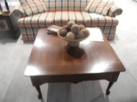 Beautiful coffee table, plaid sofa