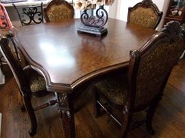 Opulent Michael Amini AICO dining room table and 6 chairs, in beautiful condition.