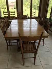 Antique oak tiger claw dining table/ 3 leaves/6 cane bottom chairs