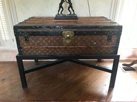 Louis Vuitton trunk on stand